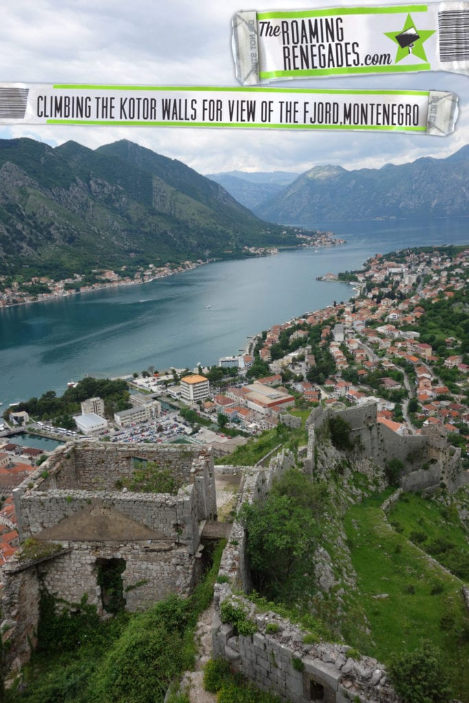 Walking the ancient city walls of Kotor Old Town for a view down the stunning fjord >