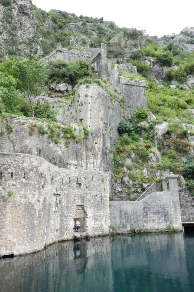 Walking the ancient city walls of Kotor Old Town for a view down the stunning fjord, things to do in kotor, walls, fortification, ramparts, castle, views, kotor bay, views, explore, adventure, hike