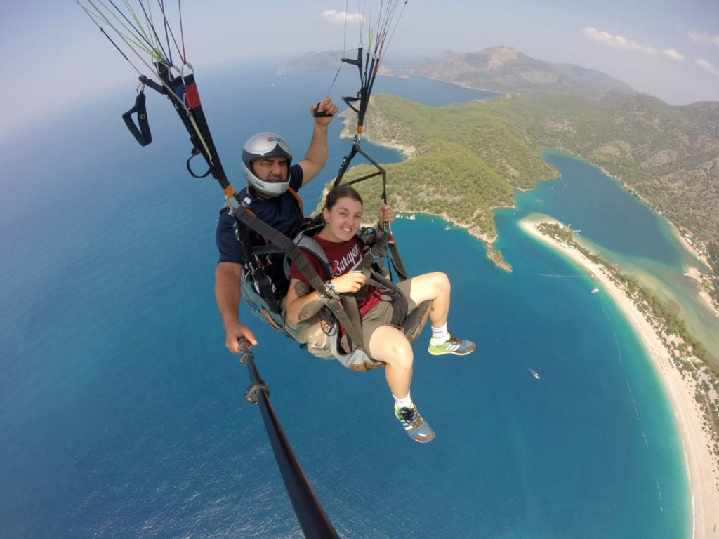 Paragliding off a mountain and landing on the beach, Oludeniz, Turkey