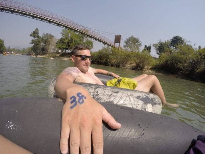party, Tubing in Vang Vieng: Why this wonderful way to see this beautiful town doesn't need to be marred with debauchery and drunkenness, tubing Vang Vieng, activities Vang Vieng, adventure, river, kayak, prices, tuk tuk, how much is tubing in Vang Vieng, drunk, bars, death, backpackers, mountains, peaceful,