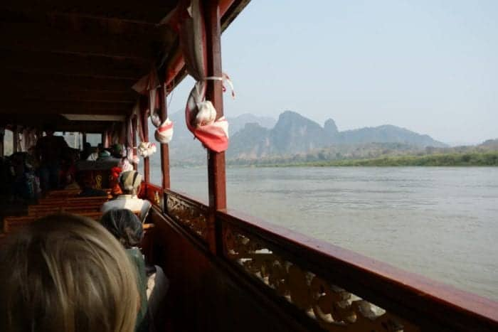 Luang Prabang to Chiang Mai slow boat, Taking the 2 day slow boat down the Mekong River from Luang Prabang, Laos to Chiang Rai, Thailand and how to do it yourself, two day, slow boat, Laos, Pak Beng, Huay Xai, Chiang Mai, Chiang Rai, Chiang Khong, tuk tuk, price, time, how long does the slow boat take, how to take the slow boat from Laos to Thailand, Thailand to Laos, Luang Prabang to Chiang Mai, backpacking, Chiang Mai to Laos slow boat, Boat from Thailand to Laos, Mekong, River cruise, Luang Prabang to Chiang Mai, Slow boat