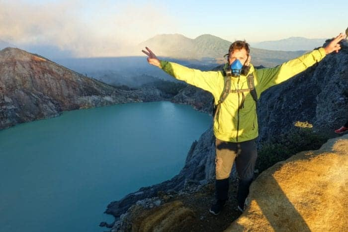 Ijen volcano hike, Climbing the smouldering live volcano Mt Ijen in protective masks for sunrise over the sulphuric acid lake and blue flame crater, Indonesia, Karangasem, Ijen price, ijen volcano cost, Ijen volcano, Ijen Crater, Ijen volcano blue flame, blue fire, Ijen crater tour, ijen plateau, ijen volcano tour, ijen and Bromo, Ijen acid lake, ijen and Bromo tour, ijen from Bali, Ijen to Bali, Gas mask volcano, dangerous hike, most dangerous hikes, Indonesia volcano, Java, Probelingo, homestay, accommodation, Kawah Ijen, Banyuwangi, Acid lake, Blue lagoon, crater lake, acid volcano lake, volcano erupt, sulphur mining, sulphur smoke,
